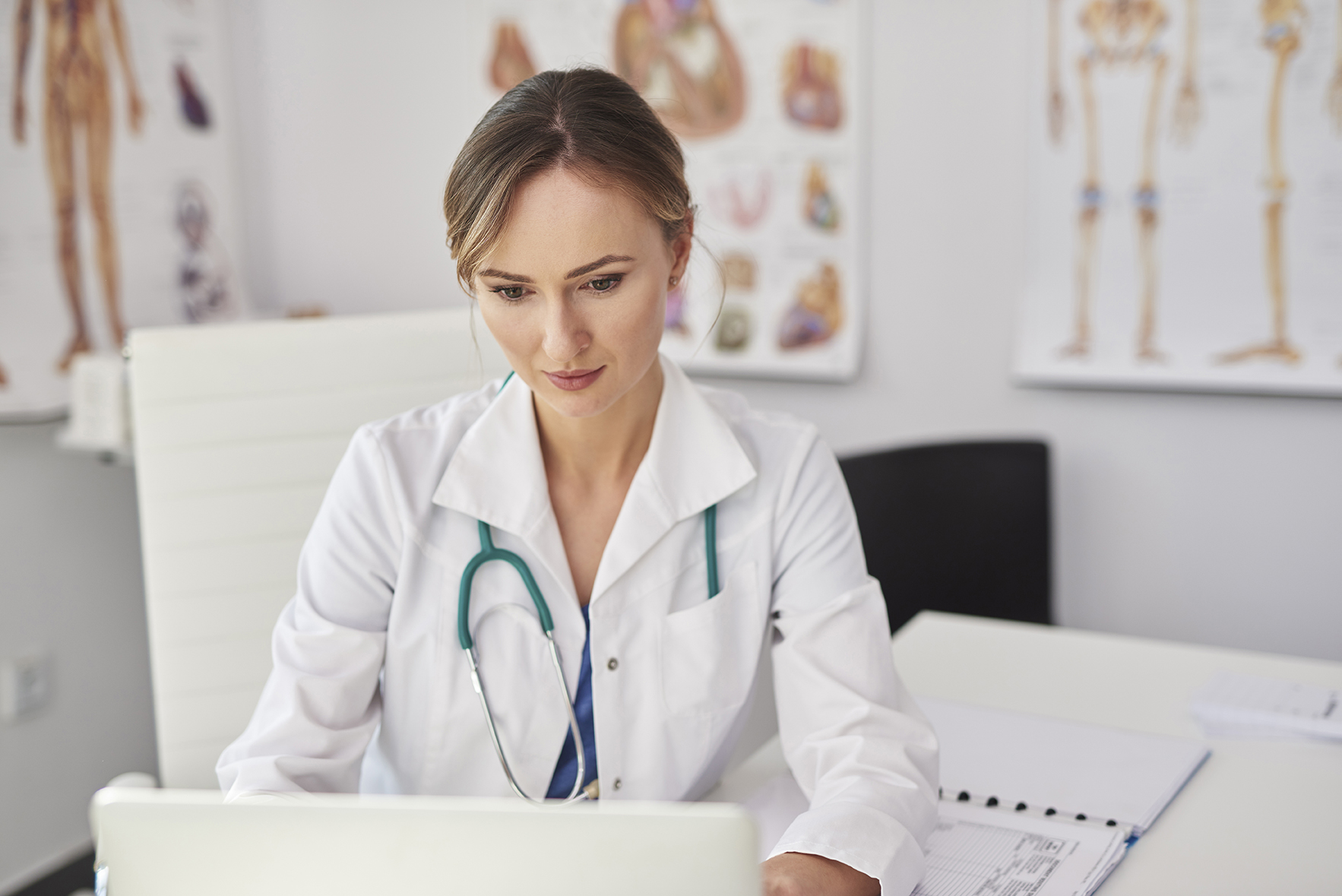 Female doctor working with technology in doctor's office